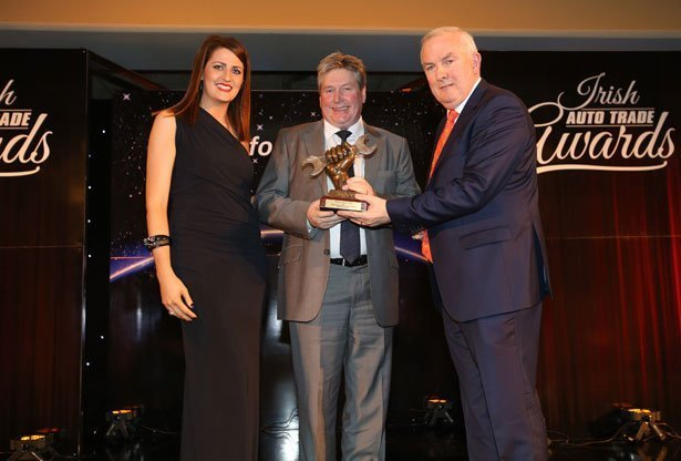 HBA founder Dermot Haughey accepts award at Irish Auto Trade Awards.