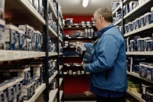 Man in blue jacket stocking Bosch products in HBA Powerstore.