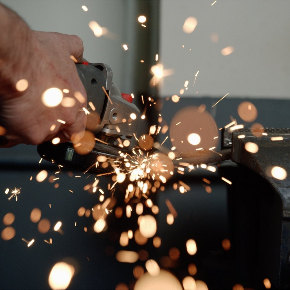 Grinder in action with sparks flying.